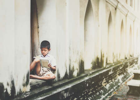 Asian children in rural areas enjoy their peaceful local life. Stock Photo