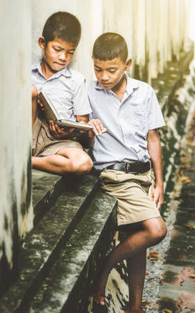 Asian children in rural areas enjoy their peaceful local life. Reklamní fotografie