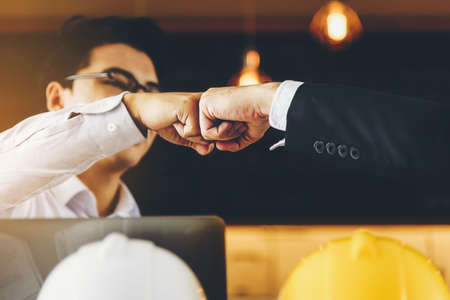 Engineer and businessman handshake,fist collide agreement in negotiations in Business conference finish.