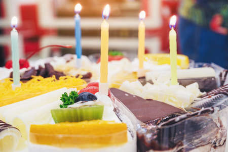 Fresh milk cakes and beautifully decorated fruits with birthday candles prepared to surprise.