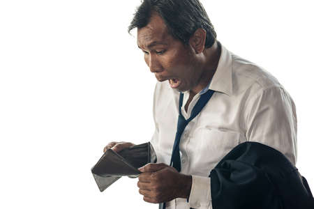 A middle aged Asian business man is shocked by his empty wallet