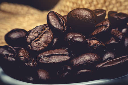 The raw coffee beans are preparing to grind into delicious coffee.