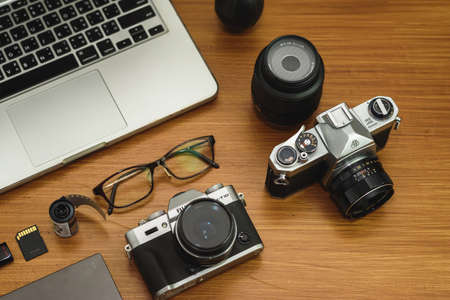 Camera, lens and photographer equipment that is ready to work on the wooden. top view. Stockfoto