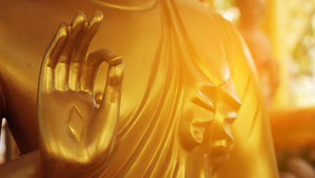 The hand of the Buddha statue is a Buddhist statue.