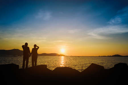 Silhouette of a lover watching the sunset in the evening.
