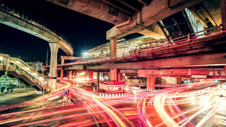 Roads and bridges during the night time traffic management in Bangkok, Thailand.