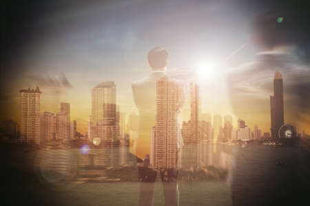 Business people standing and looking back at the business city.This image is double exposure soft focus background. Stockfoto