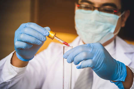 The doctor is experimenting with blood samples to prevent and treat epidemics.