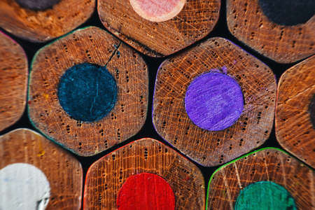 Many wooden crayons that have been used in the dark background are macro images. Stockfoto