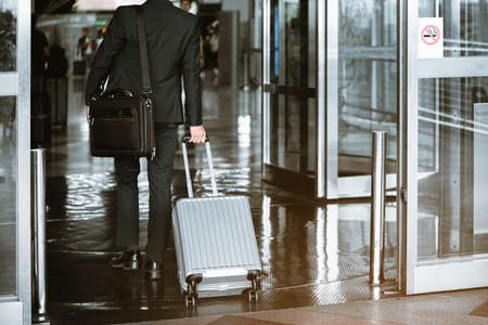 Business travelers are traveling into the country to do business while waiting for the airport trip.