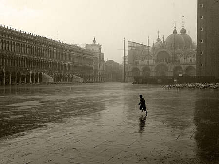 Running child on St Marks Square     photo