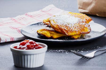 Pumpkin pancakes with marmelade and powdered sugar