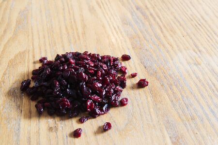 res: Dried cranberries on a wood table - Image