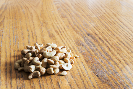 res: Cashew nuts on a wooden table - High res picture
