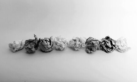 paper wad: Paper balls on a line in greyscale