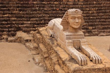 sphinx: Sphinx stutae model with pyramid background