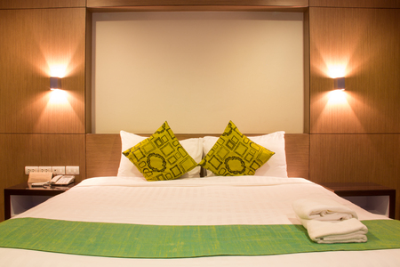 bedspread: Interior design: Bed with light in hotel