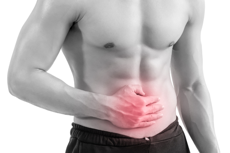 A muscle man with stomach pain, isolated on white background