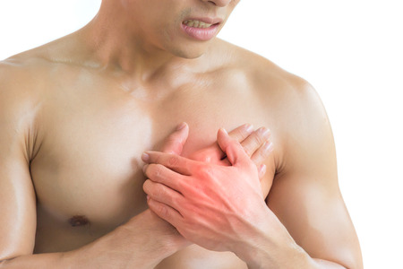 Heart attack, A muscular man are pained on his chest on white background