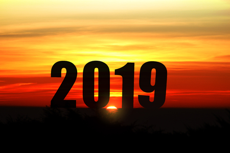 Silhouette landscape with sunlight and 2019 years for background of celebrating new year