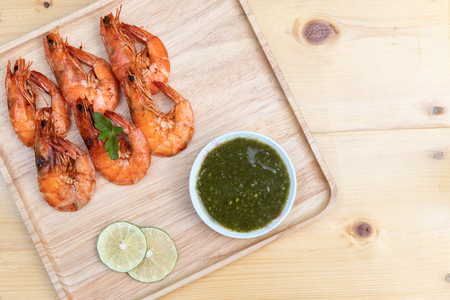 Baked Shrimp salt on wooden dish with thai chili sauce, Sea food  with copy space