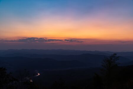 A beautiful colorful of sky and sunrise on the mountain