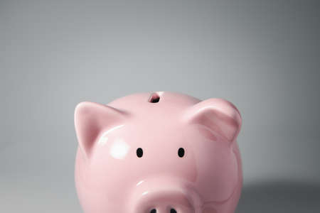 Close up haft body of Piggy bank and copyspace for Finance, saving money and debtless concept 免版税图像