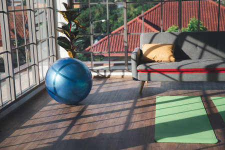Exercise blue color ball in living room. Equipment for  Indoor sport fitness and Yoga at home