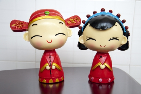 Wearing traditional Chinese wedding dress porcelain dolls