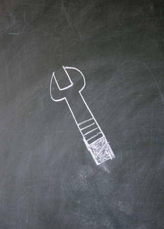 wrench drawn with chalk on blackboard photo