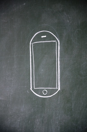 cellular phone sign drawn with chalk on blackboard photo