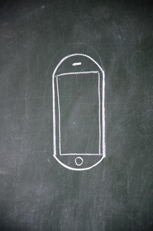 cellular phone sign drawn with chalk on blackboard