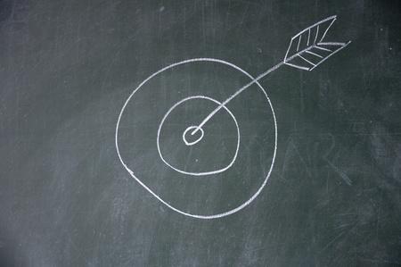 intent: arrow target drawn with chalk on blackboard Stock Photo