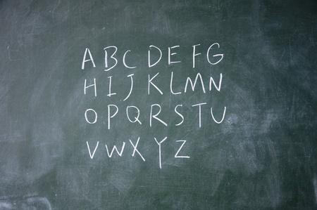lacunae: Alphabet written with chalk on blackboard Stock Photo