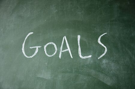 intent: goals title drawn with chalk on blackboard