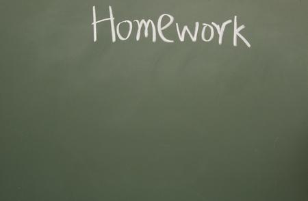 homework title written with chalk on blackboard Stock Photo - 11998644