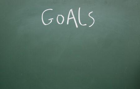 goals title handwritten with white chalk on blackboard photo