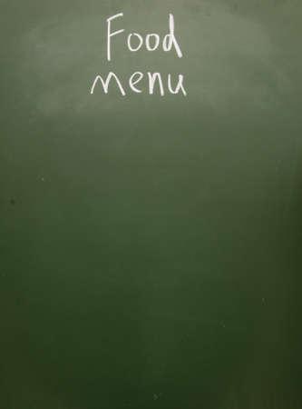 food menu title written with chalk on blackboard photo