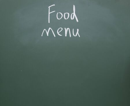 food menu title written with chalk on blackboard photo