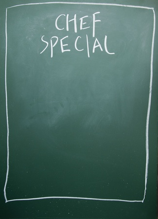 log wall: chef special sign drawn with chalk on blackboard
