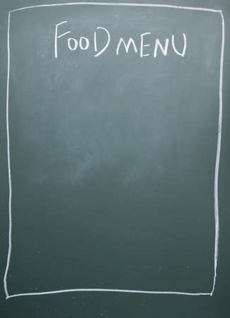 foodmenu title written with chalk on blackboard photo