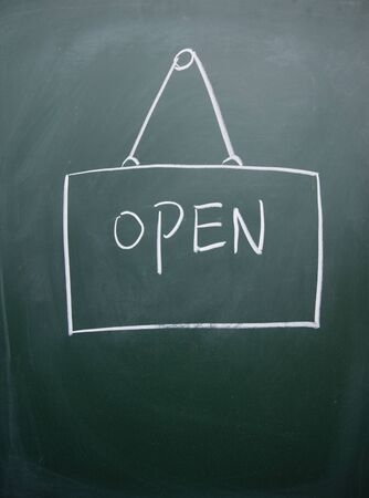 open sign drawn with chalk on blackboard