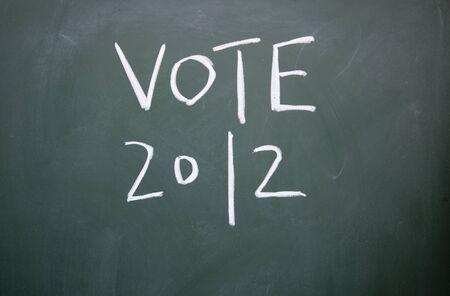 vote title written with chalk on blackboard photo