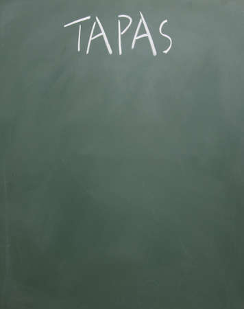 tapas title written with chalk on blackboard photo