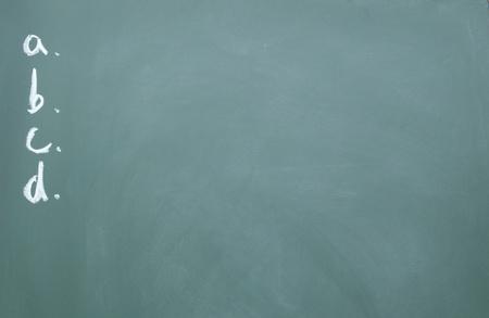 a、b、c、d title written with chalk on blackboard photo