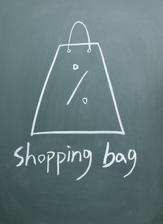 shopping bag drawn with chalk on blackboard photo