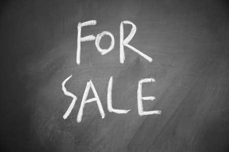 for sale title written chalk on blackboard photo