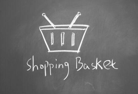 shopping basket drawn with chalk on blackboard Stock Photo - 12022460