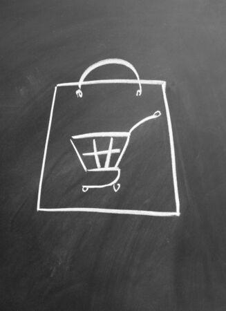 Electronic shopping cart drawn with chalk on blackboard Stock Photo - 12022599