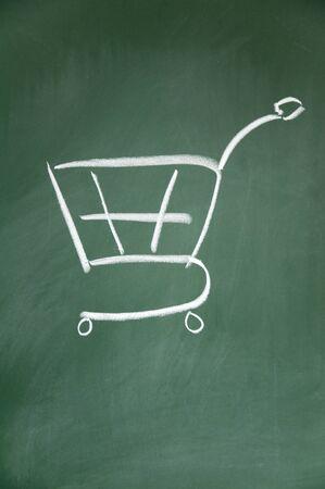 lacunae: shopping cart drawn with chalk on blackboard